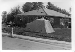 Tent erected in front yard of damaged home_access.jpg