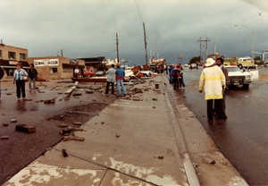 Rescue workers and residents assessing damage_access.jpg