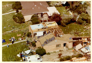 Residents assessing damage to a home_access.jpg